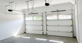 Garage door with torsion spring system
